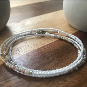 Pearl and natural tone wrap bracelet